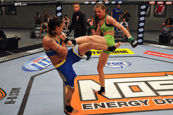 LAS VEGAS, NV - JUNE 17:  (R-L) Jessamyn Duke kicks Raquel Pennington in their preliminary fight during filming of season eighteen of The Ultimate Fighter on June 17, 2013 in Las Vegas, Nevada. (Photo by Jeff Bottari/Zuffa LLC/Zuffa LLC via Getty Images) *** Local Caption *** Raquel Pennington; Jessamyn Duke