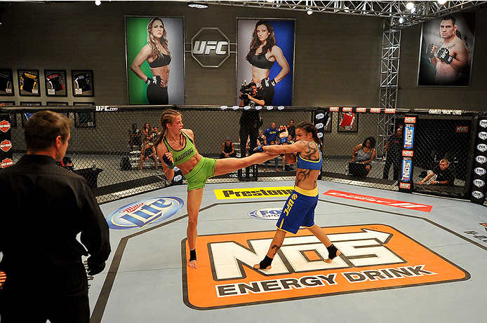 LAS VEGAS, NV - JUNE 17:  (L-R) Jessamyn Duke kicks Raquel Pennington in their preliminary fight during filming of season eighteen of The Ultimate Fighter on June 17, 2013 in Las Vegas, Nevada. (Photo by Jeff Bottari/Zuffa LLC/Zuffa LLC via Getty Images) *** Local Caption *** Raquel Pennington; Jessamyn Duke