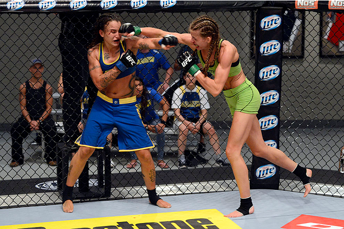 LAS VEGAS, NV - JUNE 17:  (R-L) Jessamyn Duke punches Raquel Pennington in their preliminary fight during filming of season eighteen of The Ultimate Fighter on June 17, 2013 in Las Vegas, Nevada. (Photo by Jeff Bottari/Zuffa LLC/Zuffa LLC via Getty Images) *** Local Caption *** Raquel Pennington; Jessamyn Duke