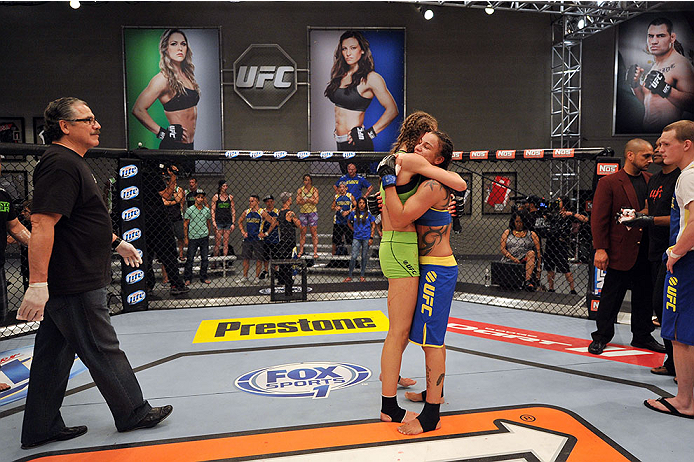 LAS VEGAS, NV - JUNE 17:  (L-R) Jessamyn Duke embraces Raquel Pennington after their preliminary fight during filming of season eighteen of The Ultimate Fighter on June 17, 2013 in Las Vegas, Nevada. (Photo by Jeff Bottari/Zuffa LLC/Zuffa LLC via Getty Images) *** Local Caption *** Raquel Pennington; Jessamyn Duke