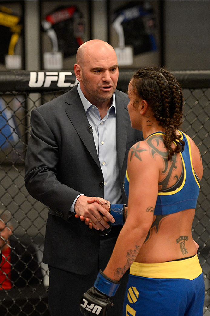 LAS VEGAS, NV - JUNE 17:  (L-R) UFC President Dana White congratulates Raquel Pennington after defeating Jessamyn Duke (not pictured) in their preliminary fight during filming of season eighteen of The Ultimate Fighter on June 17, 2013 in Las Vegas, Nevada. (Photo by Jeff Bottari/Zuffa LLC/Zuffa LLC via Getty Images) *** Local Caption *** Dana White; Raquel Pennington
