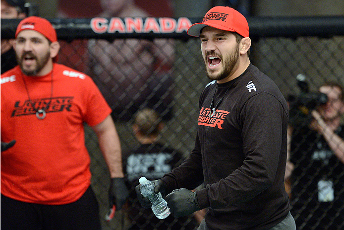 LACHUTE, CANADA - NOVEMBER 17:  Team Canada coach Patrick Cote cheers on his fighter Sheldon Westcott after submitting Team Australia fighter Daniel Kelly in their middleweight fight during filming of The Ultimate Fighter Nations television series on November 17, 2013 in Lachute, Quebec, Canada. (Photo by Richard Wolowicz/Zuffa LLC/Zuffa LLC via Getty Images) *** Local Caption *** Patrick Cote