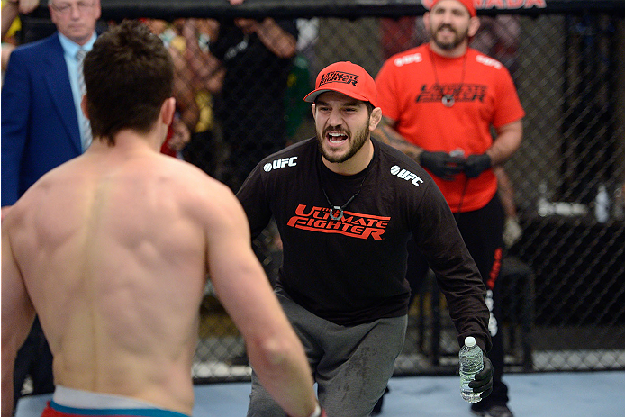 LACHUTE, CANADA - NOVEMBER 17:  Team Canada coach Patrick Cote cheers on his fighter Sheldon Westcott after submitting Team Australia fighter Daniel Kelly in their middleweight fight during filming of The Ultimate Fighter Nations television series on November 17, 2013 in Lachute, Quebec, Canada. (Photo by Richard Wolowicz/Zuffa LLC/Zuffa LLC via Getty Images) *** Local Caption *** Sheldon Westcott; Patrick Cote