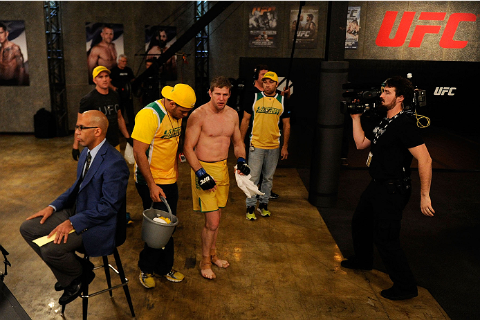 LACHUTE, CANADA - NOVEMBER 17:  Team Australia fighter Daniel Kelly walks to the locker room after being submitted by Team Canada fighter Sheldon Westcott in their middleweight fight during filming of The Ultimate Fighter Nations television series on November 17, 2013 in Lachute, Quebec, Canada. (Photo by Richard Wolowicz/Zuffa LLC/Zuffa LLC via Getty Images) *** Local Caption *** Daniel Kelly