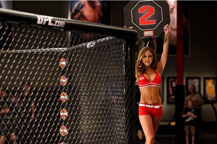LAS VEGAS, NV - JUNE 19: UFC Octagon Girl Brittney Palmer introduces round two of Wooten v Hill in their preliminary fight during filming of season eighteen of The Ultimate Fighter on June 19, 2013 in Las Vegas, Nevada. (Photo by Josh Hedges/Zuffa LLC/Zuffa LLC via Getty Images) *** Local Caption *** Brittney Palmer