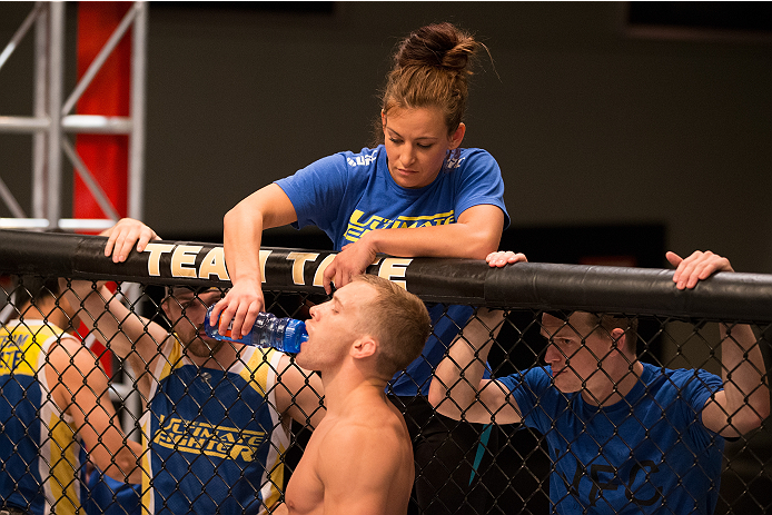 LAS VEGAS, NV - JUNE 19: Coach Miesha Tate stands in the corner of Josh Hill before his preliminary fight against Michael Wooten (not pictured) during filming of season eighteen of The Ultimate Fighter on June 19, 2013 in Las Vegas, Nevada. (Photo by Josh Hedges/Zuffa LLC/Zuffa LLC via Getty Images) *** Local Caption *** Miesha Tate; Josh Hill