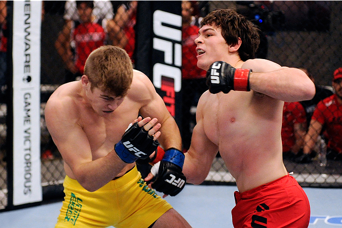 Olivier Aubin-Mercier punches <a href='../fighter/jake-matthews'>Jake Matthews</a> in their fight during filming of <a href='../event/Ultimate-Fighter-Team-Serra-vs-Team-Hughes-Finale'><a href='../event/The-Ultimate-Fighter-Team-US-vs-Team-UK-FINALE'><a href='../event/The-Ultimate-Fighter-Heavyweights-FINALE'>The Ultimate Fighter </a></a></a>Nations television series on November 20, 2013 in Lachute, Quebec, Canada. (Photo by Richard Wolowicz/Zuffa LLC)
