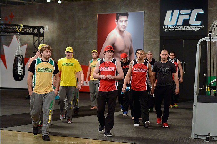 LACHUTE, CANADA - DECEMBER 2:  Team Australia and Team Canada fighter walk into the gym during filming of The Ultimate Fighter Nations television series on December 2, 2013 in Lachute, Quebec, Canada. (Photo by Richard Wolowicz/Zuffa LLC/Zuffa LLC via Getty Images) *** Local Caption ***