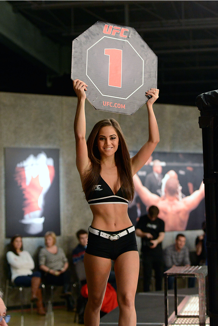 LACHUTE, CANADA - DECEMBER 2:  UFC Octagon Girl Stephanie Serfaty signals the start of round one between Team Australia fighter Vik Grujic and Team Canada fighter Luke Harris in their middleweight fight during filming of The Ultimate Fighter Nations television series on December 2, 2013 in Lachute, Quebec, Canada. (Photo by Richard Wolowicz/Zuffa LLC/Zuffa LLC via Getty Images) *** Local Caption *** Stephanie Serfaty