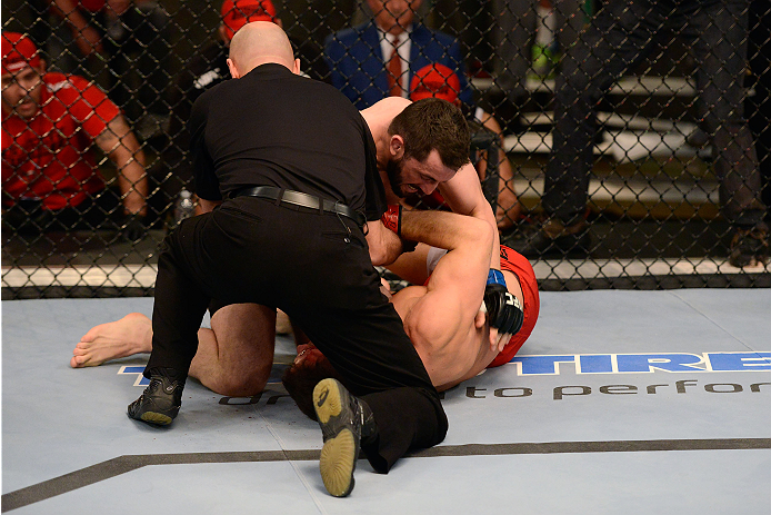 LACHUTE, CANADA - DECEMBER 2:  (L-R) Team Australia fighter Vik Grujic is pulled off Team Canada fighter Luke Harris by referee Yves Lavigne in their middleweight fight during filming of The Ultimate Fighter Nations television series on December 2, 2013 in Lachute, Quebec, Canada. (Photo by Richard Wolowicz/Zuffa LLC/Zuffa LLC via Getty Images) *** Local Caption *** Vik Grujic; Luke Harris; Yves Lavigne
