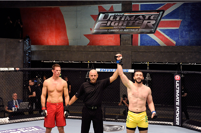LACHUTE, CANADA - DECEMBER 2:  Team Australia fighter Vik Grujic (R) is declared the winner over Team Canada fighter Luke Harris by referee Yves Lavigne after their middleweight fight during filming of The Ultimate Fighter Nations television series on December 2, 2013 in Lachute, Quebec, Canada. (Photo by Richard Wolowicz/Zuffa LLC/Zuffa LLC via Getty Images) *** Local Caption *** Vik Grujic; Luke Harris; Yves Lavigne