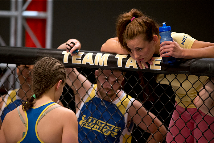 LAS VEGAS, NV - JUNE 21:  Coach Miesha Tate (R) stands in the corner of Sarah Moras (L) before her preliminary fight against Peggy Morgan (not pictured) during filming of season eighteen of The Ultimate Fighter on June 21, 2013 in Las Vegas, Nevada. (Photo by Josh Hedges/Zuffa LLC/Zuffa LLC via Getty Images) *** Local Caption *** Miesha Tate; Sarah Moras