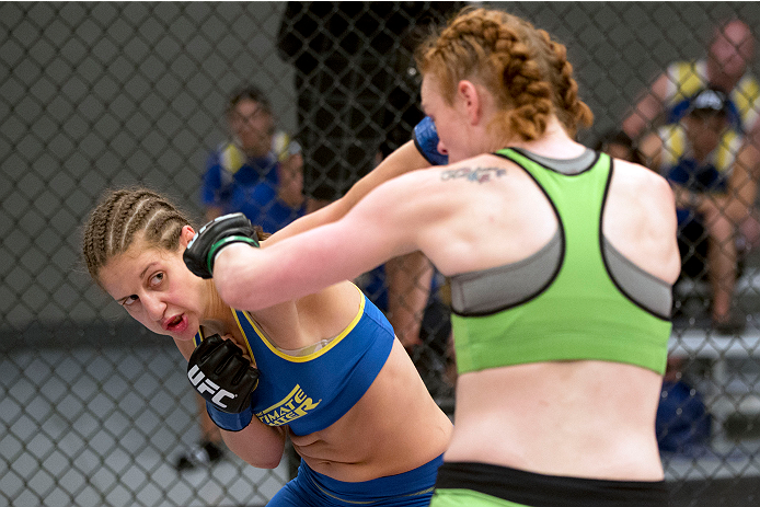 LAS VEGAS, NV - JUNE 21:  (L-R) Sarah Moras punches Margaret Morgan in their preliminary fight during filming of season eighteen of The Ultimate Fighter on June 21, 2013 in Las Vegas, Nevada. (Photo by Josh Hedges/Zuffa LLC/Zuffa LLC via Getty Images) *** Local Caption *** Sarah Moras; Margaret Morgan