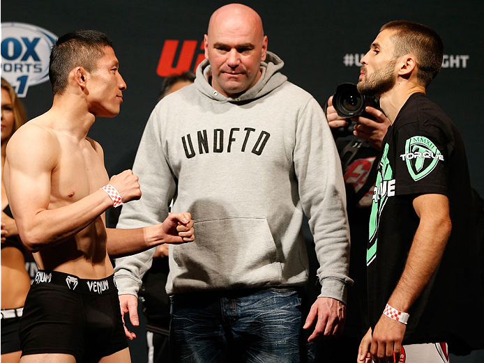 CINCINNATI, OH - MAY 09:  Opponents Kyoji Horiguchi (L) and Darrell Montague face off watched by UFC President Dana White during the UFC weigh-in at the U.S. Bank Arena on May 9, 2014 in Cincinnati, Ohio. (Photo by Josh Hedges/Zuffa LLC/Zuffa LLC via Getty Images)
