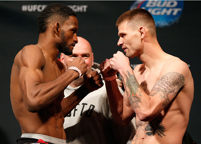 CINCINNATI, OH - MAY 09:  (L-R) Opponents Neil Magny and Tim Means face off during the UFC weigh-in at the U.S. Bank Arena on May 9, 2014 in Cincinnati, Ohio. (Photo by Josh Hedges/Zuffa LLC/Zuffa LLC via Getty Images)
