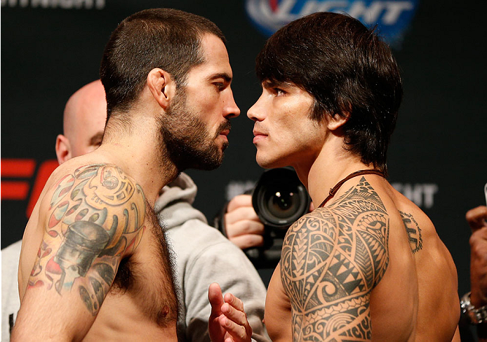 CINCINNATI, OH - MAY 09:  (L-R) Opponents Matt Brown and Erick Silva face off during the UFC weigh-in at the U.S. Bank Arena on May 9, 2014 in Cincinnati, Ohio. (Photo by Josh Hedges/Zuffa LLC/Zuffa LLC via Getty Images)