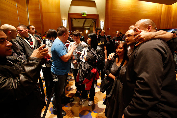 SEATTLE, WA - DECEMBER 05:  BJ Penn poses for photos with fans during the UFC on FOX open workouts on December 5, 2012  at the Grand Hyatt Seattle in Seattle, Washington.  (Photo by Josh Hedges/Zuffa LLC/Zuffa LLC via Getty Images)
