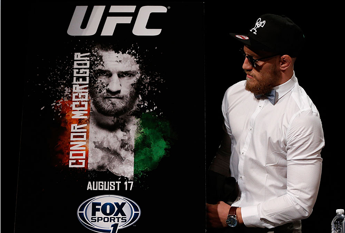 BOSTON, MA - AUGUST 15:  UFC featherweight Conor McGregor unveils the winning design for a fan poster contest during a UFC press conference at the Wang Theatre on August 15, 2013 in Boston, Massachusetts. (Photo by Josh Hedges/Zuffa LLC/Zuffa LLC via Getty Images)