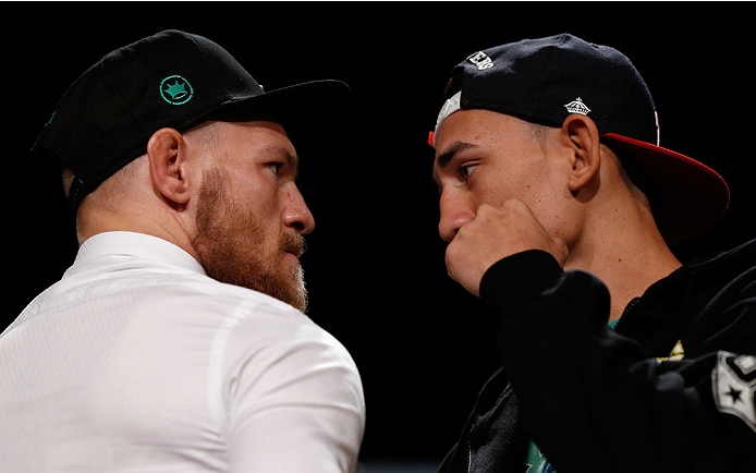 BOSTON, MA - AUGUST 15:  (L-R) Opponents Conor McGregor and Max Holloway face off during a UFC press conference at the Wang Theatre on August 15, 2013 in Boston, Massachusetts. (Photo by Josh Hedges/Zuffa LLC/Zuffa LLC via Getty Images)