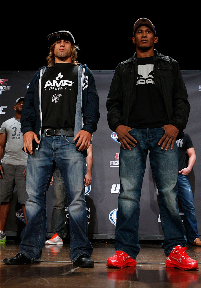 BOSTON, MA - AUGUST 15:  (L-R) Opponents Urijah Faber and Iuri Alcantara pose for photos during a UFC press conference at the Wang Theatre on August 15, 2013 in Boston, Massachusetts. (Photo by Josh Hedges/Zuffa LLC/Zuffa LLC via Getty Images)