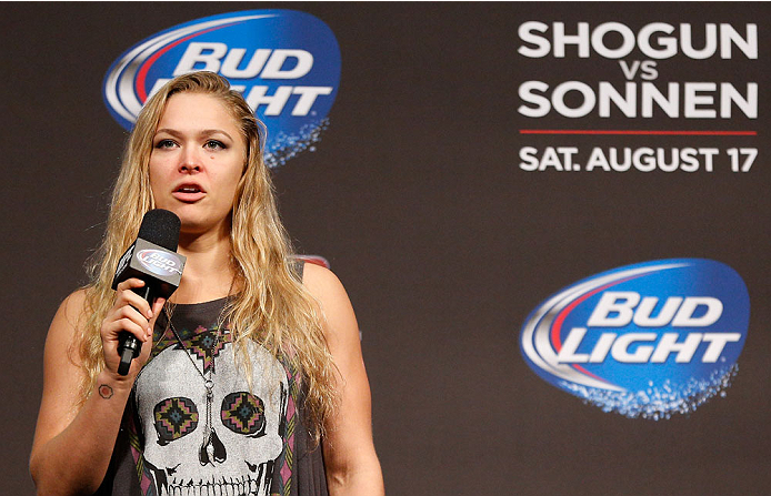 BOSTON, MA - AUGUST 16:  UFC women's bantamweight champion Ronda Rousey interacts with fans during a Q&A session befofe the UFC weigh-in inside TD Garden on August 16, 2013 in Boston, Massachusetts. (Photo by Josh Hedges/Zuffa LLC/Zuffa LLC via Getty Images)