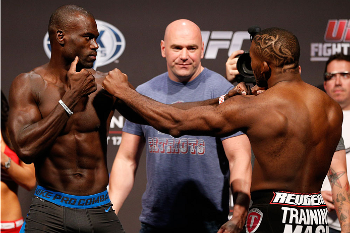 BOSTON, MA - AUGUST 16:  (L-R) Opponents Uriah Hall and John Howard face off during the UFC weigh-in inside TD Garden on August 16, 2013 in Boston, Massachusetts. (Photo by Josh Hedges/Zuffa LLC/Zuffa LLC via Getty Images)