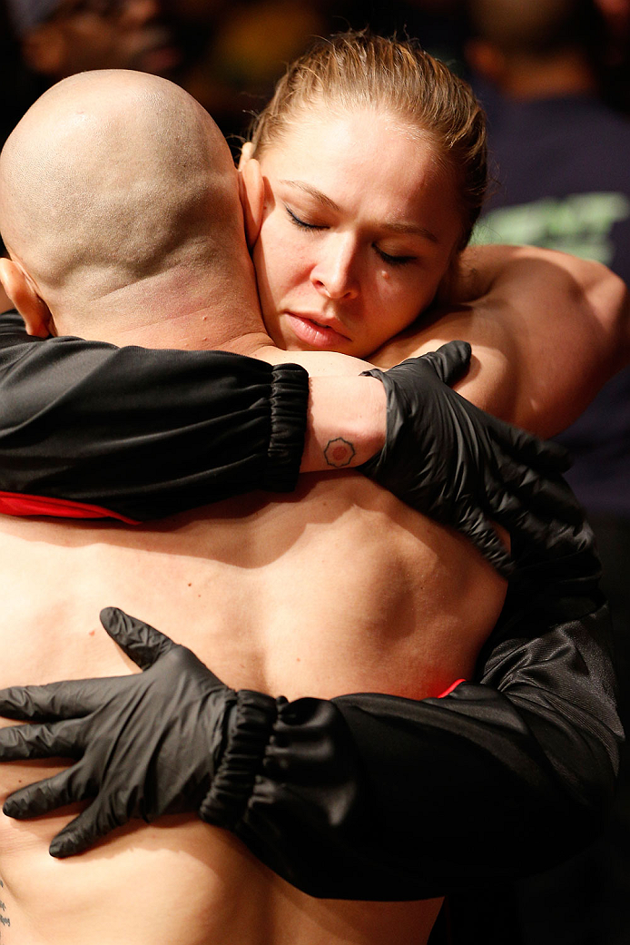 BOSTON, MA - AUGUST 17:  (R-L) UFC women's bantamweight champion Ronda Rousey supports teammate Manny Gamburyan during his UFC featherweight bout against Cole Miller at TD Garden on August 17, 2013 in Boston, Massachusetts. (Photo by Josh Hedges/Zuffa LLC/Zuffa LLC via Getty Images)