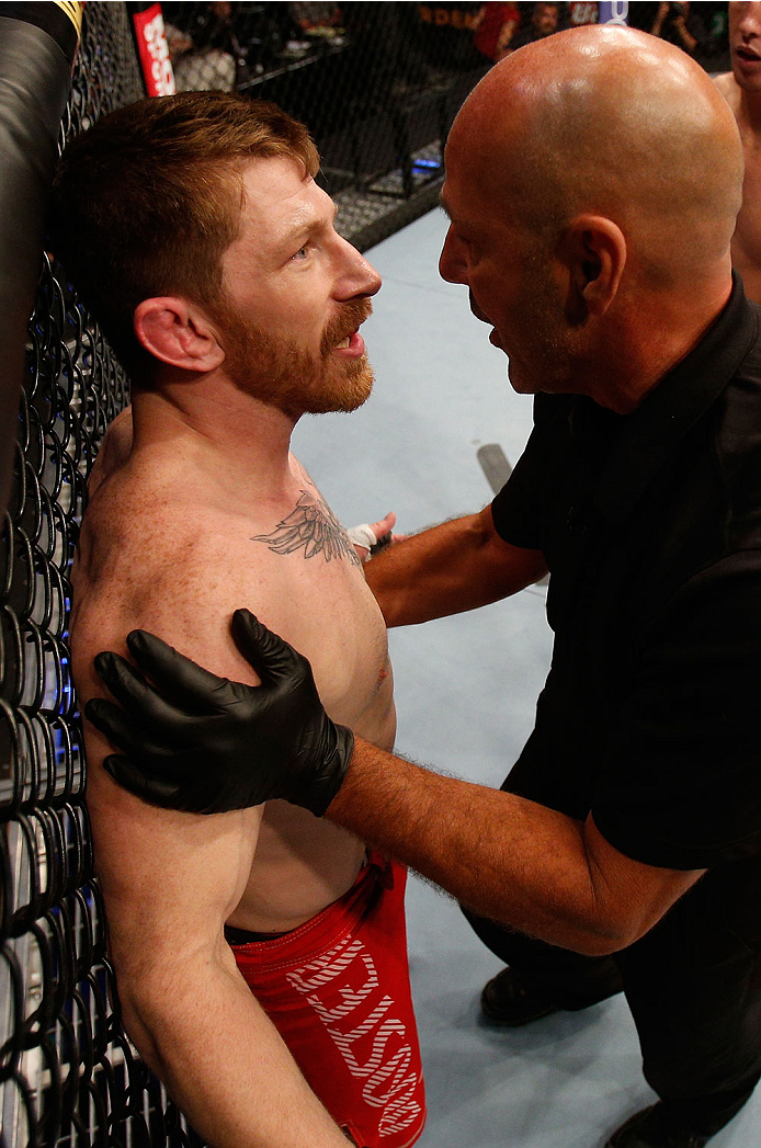 BOSTON, MA - AUGUST 17:  (L-R) Mike Brown protests to referee Yves Lavigne after his knockout loss to Steven Siler in their UFC featherweight bout at TD Garden on August 17, 2013 in Boston, Massachusetts. (Photo by Josh Hedges/Zuffa LLC/Zuffa LLC via Getty Images)