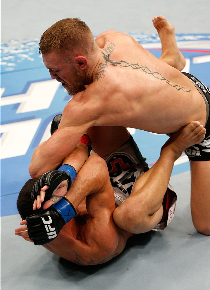 BOSTON, MA - AUGUST 17:  (R-L) Conor McGregor elbows Max Holloway in their UFC featherweight bout at TD Garden on August 17, 2013 in Boston, Massachusetts. (Photo by Josh Hedges/Zuffa LLC/Zuffa LLC via Getty Images)