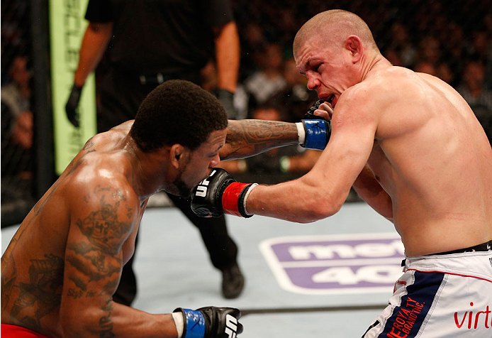 BOSTON, MA - AUGUST 17:  (L-R) Michael Johnson punches Joe Lauzon in their UFC lightweight bout at TD Garden on August 17, 2013 in Boston, Massachusetts. (Photo by Josh Hedges/Zuffa LLC/Zuffa LLC via Getty Images)