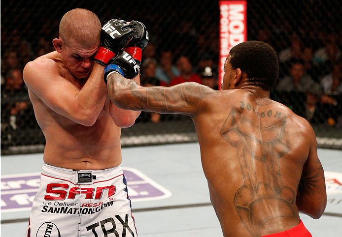 BOSTON, MA - AUGUST 17:  (R-L) Michael Johnson punches Joe Lauzon in their UFC lightweight bout at TD Garden on August 17, 2013 in Boston, Massachusetts. (Photo by Josh Hedges/Zuffa LLC/Zuffa LLC via Getty Images)