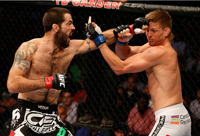 BOSTON, MA - AUGUST 17:  (L-R) Matt Brown punches Mike Pyle in their UFC welterweight bout at TD Garden on August 17, 2013 in Boston, Massachusetts. (Photo by Josh Hedges/Zuffa LLC/Zuffa LLC via Getty Images)