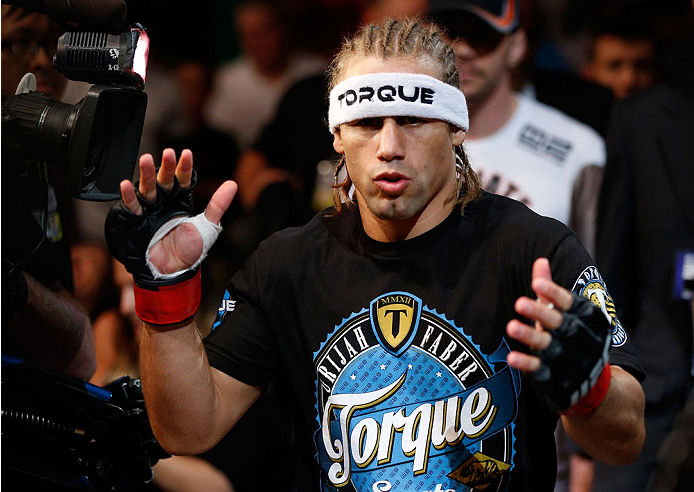 BOSTON, MA - AUGUST 17:  Urijah Faber enters the arena before his UFC bantamweight bout against Iuri Alcantara at TD Garden on August 17, 2013 in Boston, Massachusetts. (Photo by Josh Hedges/Zuffa LLC/Zuffa LLC via Getty Images)