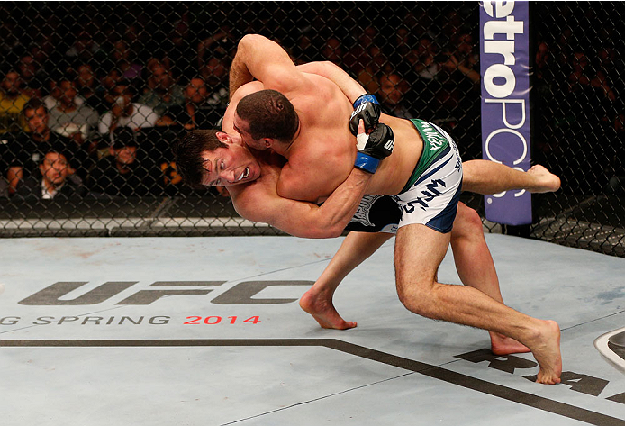 "BOSTON, MA - AUGUST 17:  (L-R) Chael Sonnen takes down Mauricio ""Shogun"" Rua in their UFC light heavyweight bout at TD Garden on August 17, 2013 in Boston, Massachusetts. (Photo by Josh Hedges/Zuffa LLC/Zuffa LLC via Getty Images)"