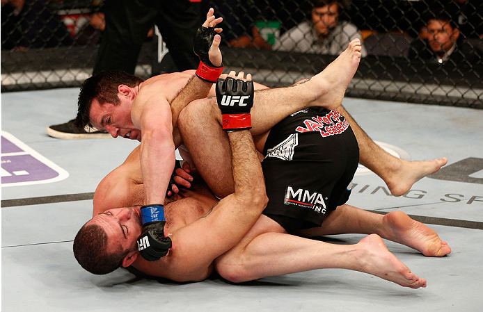 "BOSTON, MA - AUGUST 17:  Chael Sonnen (top) punches Mauricio ""Shogun"" Rua in their UFC light heavyweight bout at TD Garden on August 17, 2013 in Boston, Massachusetts. (Photo by Josh Hedges/Zuffa LLC/Zuffa LLC via Getty Images)"