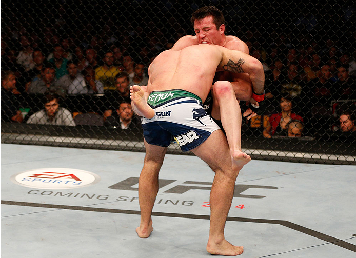 "BOSTON, MA - AUGUST 17:  (R-L) Chael Sonnen secures a guillotine choke submission against Mauricio ""Shogun"" Rua in their UFC light heavyweight bout at TD Garden on August 17, 2013 in Boston, Massachusetts. (Photo by Josh Hedges/Zuffa LLC/Zuffa LLC via Getty Images)"
