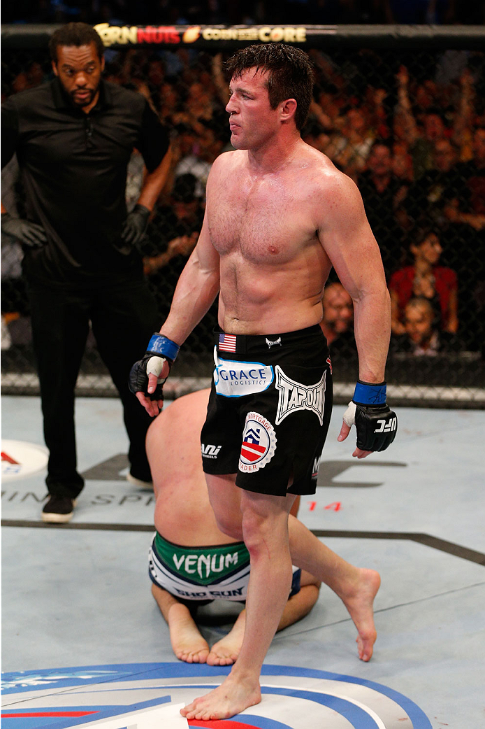 "BOSTON, MA - AUGUST 17:  Chael Sonnen reacts after his submission victory over Mauricio ""Shogun"" Rua in their UFC light heavyweight bout at TD Garden on August 17, 2013 in Boston, Massachusetts. (Photo by Josh Hedges/Zuffa LLC/Zuffa LLC via Getty Images)"