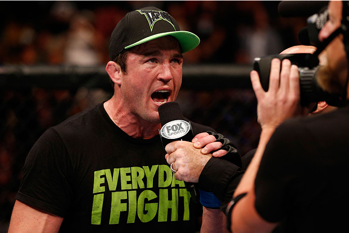 "BOSTON, MA - AUGUST 17:  Chael Sonnen is interviewed by Joe Rogan after his submission victory over Mauricio ""Shogun"" Rua in their UFC light heavyweight bout at TD Garden on August 17, 2013 in Boston, Massachusetts. (Photo by Josh Hedges/Zuffa LLC/Zuffa LLC via Getty Images)"
