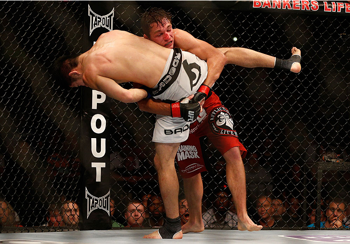 INDIANAPOLIS, IN - AUGUST 28:  (R-L) Darren Elkins takes down Hatsu Hioki in their featherweight fight during the UFC on FOX Sports 1 event at Bankers Life Fieldhouse on August 28, 2013 in Indianapolis, Indiana. (Photo by Josh Hedges/Zuffa LLC/Zuffa LLC via Getty Images)