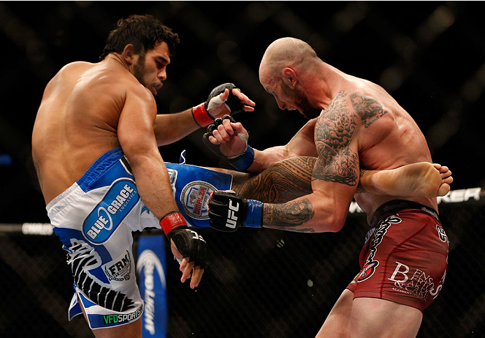 INDIANAPOLIS, IN - AUGUST 28:  (L-R) Brad Tavares kicks Bubba McDaniel in their middleweight fight during the UFC on FOX Sports 1 event at Bankers Life Fieldhouse on August 28, 2013 in Indianapolis, Indiana. (Photo by Josh Hedges/Zuffa LLC/Zuffa LLC via Getty Images)