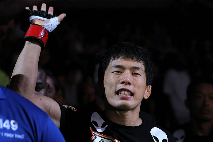 INDIANAPOLIS, IN - AUGUST 28:  Takeya Mizugaki enters the arena before his bantamweight fight against Erik Perez during the UFC on FOX Sports 1 event at Bankers Life Fieldhouse on August 28, 2013 in Indianapolis, Indiana. (Photo by Ed Mulholland/Zuffa LLC/Zuffa LLC via Getty Images)