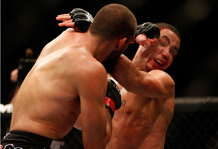 INDIANAPOLIS, IN - AUGUST 28:  (L-R) Court McGee punches Robert Whittaker in their welterweight fight during the UFC on FOX Sports 1 event at Bankers Life Fieldhouse on August 28, 2013 in Indianapolis, Indiana. (Photo by Josh Hedges/Zuffa LLC/Zuffa LLC via Getty Images)