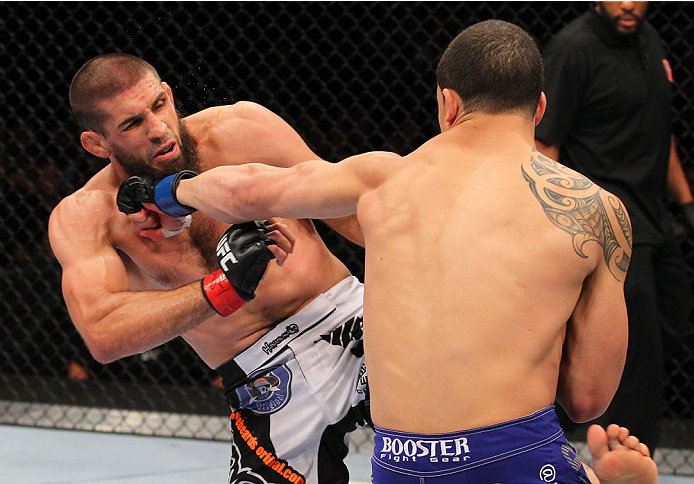 INDIANAPOLIS, IN - AUGUST 28:  (R-L) Robert Whittaker punches Court McGee in their welterweight fight during the UFC on FOX Sports 1 event at Bankers Life Fieldhouse on August 28, 2013 in Indianapolis, Indiana. (Photo by Ed Mulholland/Zuffa LLC/Zuffa LLC via Getty Images)