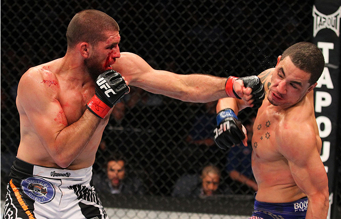 INDIANAPOLIS, IN - AUGUST 28:  (L-R) Court McGee punches Robert Whittaker in their welterweight fight during the UFC on FOX Sports 1 event at Bankers Life Fieldhouse on August 28, 2013 in Indianapolis, Indiana. (Photo by Ed Mulholland/Zuffa LLC/Zuffa LLC via Getty Images)