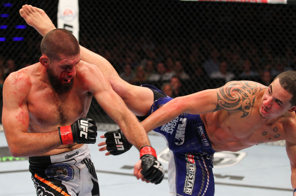 INDIANAPOLIS, IN - AUGUST 28:  (R-L) Robert Whittaker kicks Court McGee in their welterweight fight during the UFC on FOX Sports 1 event at Bankers Life Fieldhouse on August 28, 2013 in Indianapolis, Indiana. (Photo by Ed Mulholland/Zuffa LLC/Zuffa LLC via Getty Images)