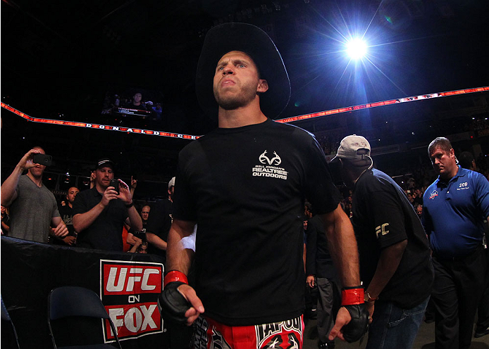"INDIANAPOLIS, IN - AUGUST 28:  Donald ""Cowboy"" Cerrone enters the arena before his lightweight fight against Rafael dos Anjos during the UFC on FOX Sports 1 event at Bankers Life Fieldhouse on August 28, 2013 in Indianapolis, Indiana. (Photo by Ed Mulholland/Zuffa LLC/Zuffa LLC via Getty Images)"