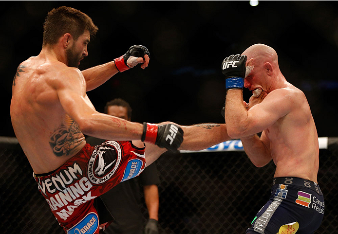 INDIANAPOLIS, IN - AUGUST 28:  (L-R) Carlos Condit kicks Martin Kampmann in their welterweight fight during the UFC on FOX Sports 1 event at Bankers Life Fieldhouse on August 28, 2013 in Indianapolis, Indiana. (Photo by Josh Hedges/Zuffa LLC/Zuffa LLC via Getty Images)