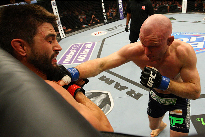 INDIANAPOLIS, IN - AUGUST 28:  (R-L) Martin Kampmann punches Carlos Condit in their welterweight fight during the UFC on FOX Sports 1 event at Bankers Life Fieldhouse on August 28, 2013 in Indianapolis, Indiana. (Photo by Ed Mulholland/Zuffa LLC/Zuffa LLC via Getty Images)