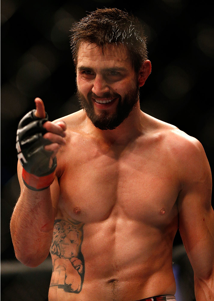 INDIANAPOLIS, IN - AUGUST 28:  Carlos Condit reacts after knocking out Martin Kampmann in their welterweight fight during the UFC on FOX Sports 1 event at Bankers Life Fieldhouse on August 28, 2013 in Indianapolis, Indiana. (Photo by Josh Hedges/Zuffa LLC/Zuffa LLC via Getty Images)