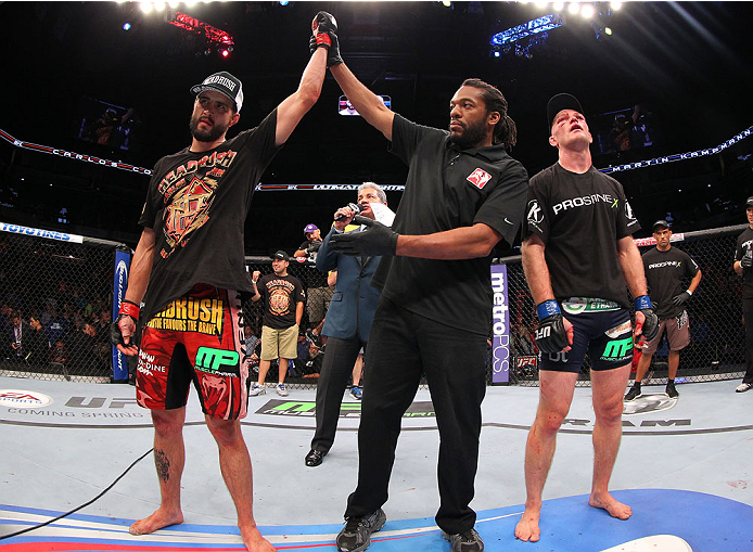 INDIANAPOLIS, IN - AUGUST 28:  Carlos Condit (L) reacts after his TKO victory over Martin Kampmann in their welterweight fight during the UFC on FOX Sports 1 event at Bankers Life Fieldhouse on August 28, 2013 in Indianapolis, Indiana. (Photo by Ed Mulholland/Zuffa LLC/Zuffa LLC via Getty Images)